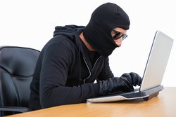 rsz_bigstock-burglar-in-sunglasses-using-la-77438636.jpg